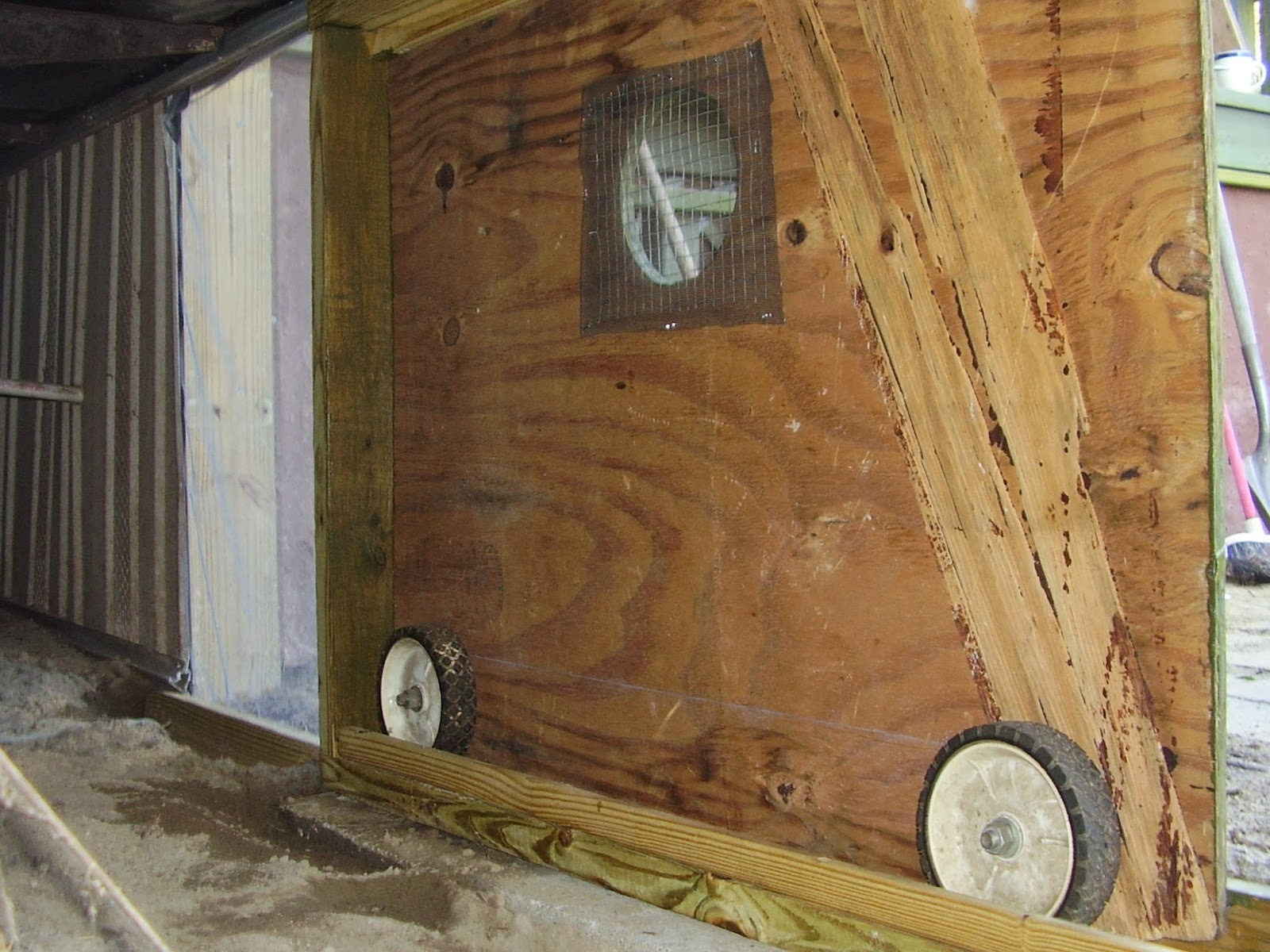Back of the sliding door showing wheels in track. & Low Rent Renaissance: Some more mobile home skirting efforts