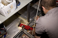 Image of Air Conditioning technician fixing ac