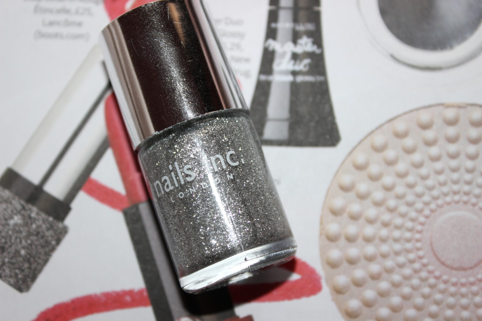 a silver glitter polish
