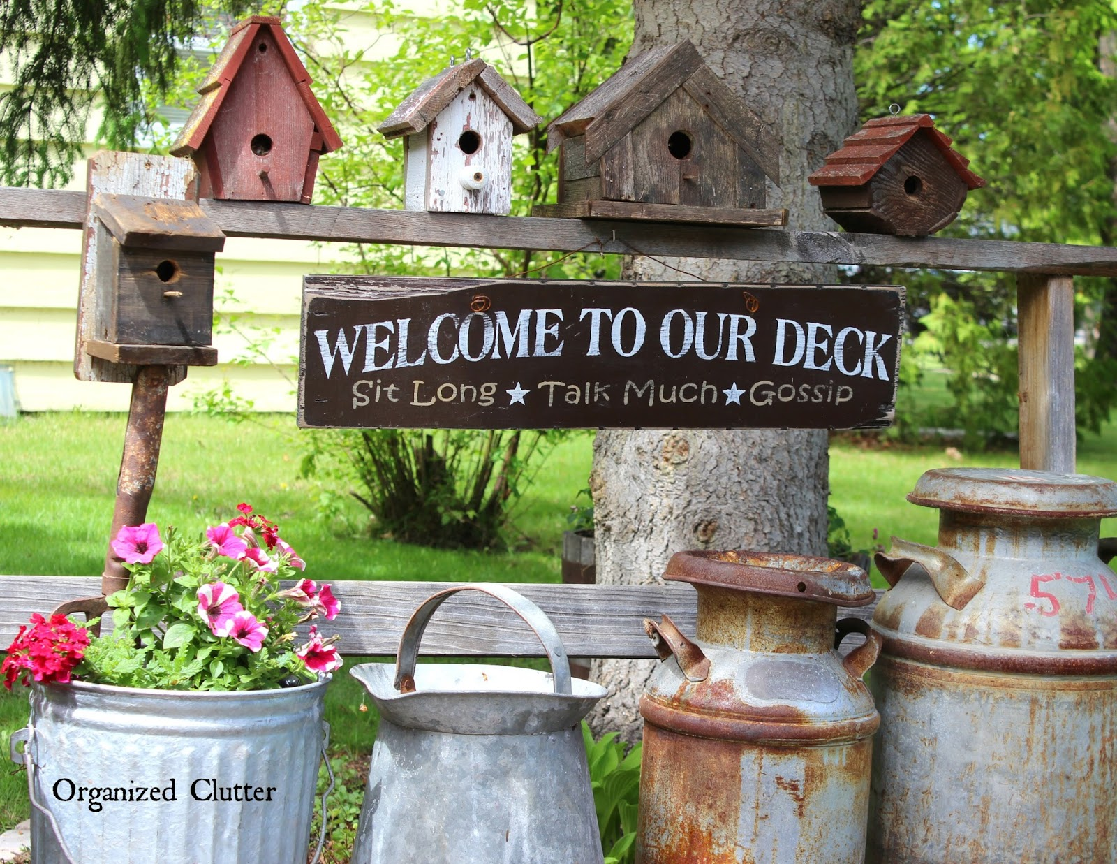 organized clutter: decorating the deck with rustic birdhouses