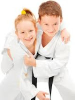 children boy and girl learn martial arts and karate
