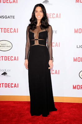 Olivia Munn flashes cleavage in sheer dress at Mortdecai premiere