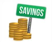 Savings sign with coins beside it