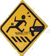 El contenido es un pictograma en el que un peatón corre por un paso de cebra asustado ante la presencia de un coche.