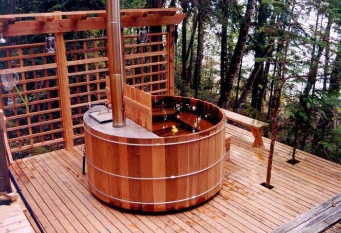 Offgrid life wood fired cedar hot tub for Outdoor bathtub wood fired
