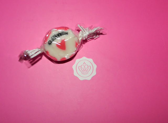 Pink valentine's themed GlossyBox with GlossyBox sweet candy