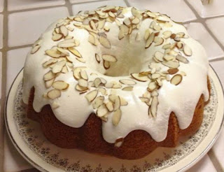 Eggnog Bundt Cake: A cake based on a yellow cake mix box mix that's made with eggnog and decorated with white icing and almonds for Christmas