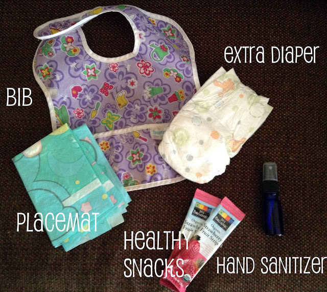 diaper bib placemat hand sanitizer snacks
