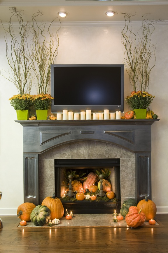 pumpkin decorated fireplace and mantel