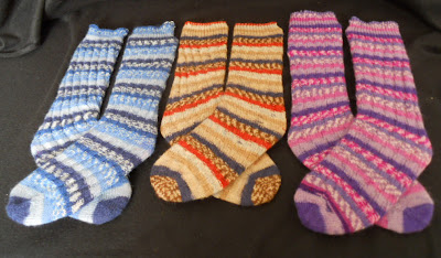 3 pairs of self-striping yarn on blockers