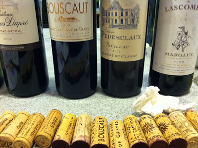 bottles of Bordeaux wine and their corks
