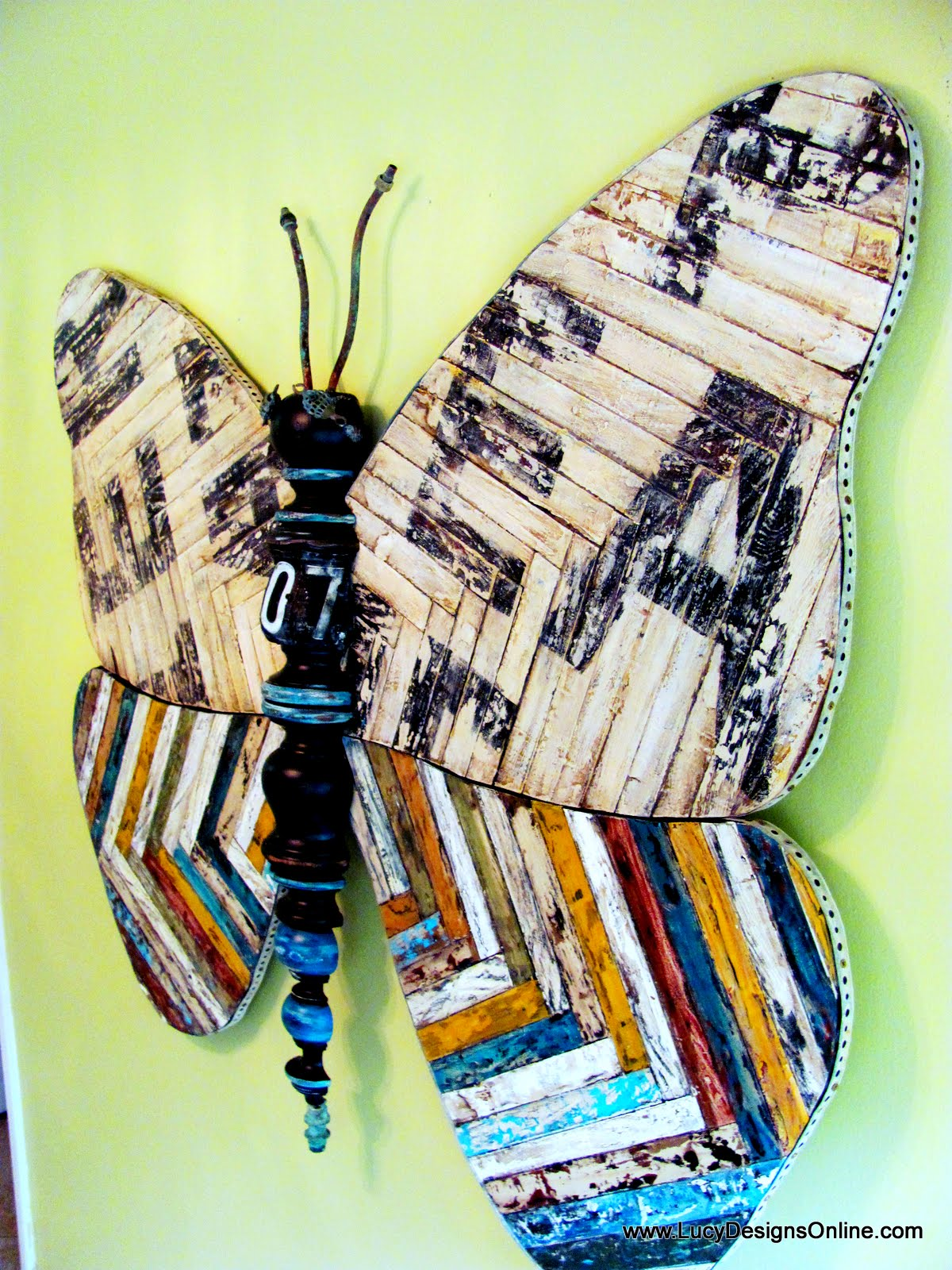Fabulous giant recycled wooden butterfly art with reclaimed wood and sign