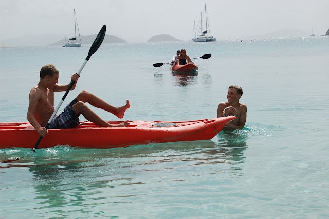 My sons trying to knock each other off the sea kayaks at Francis Bay