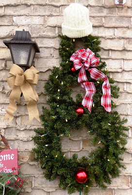 winter decorating on the porch, snowman wreath, pinecone wreath