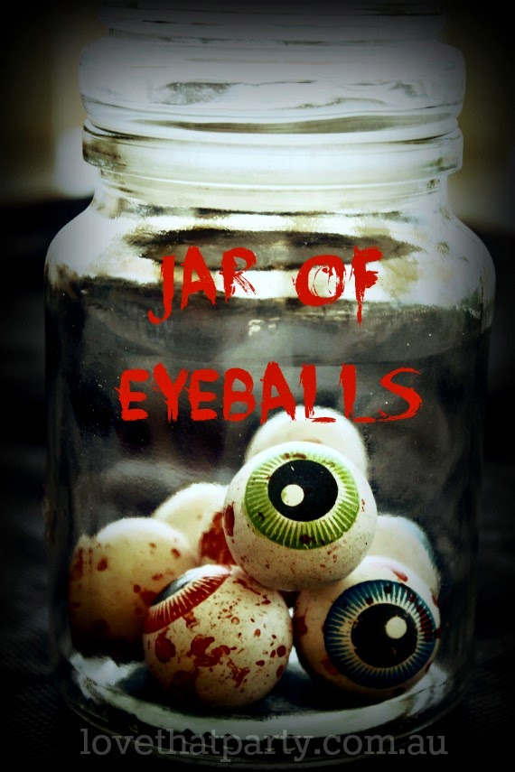 Jar of Eyeballs: for your Halloween Party table @ Love That Party. A great party site full of diy party ideas, cakes, recipes, party decorations and party printables. www.lovethatparty.com.au