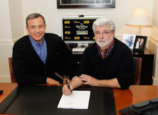 Bog Iger and George Lucas signing documents