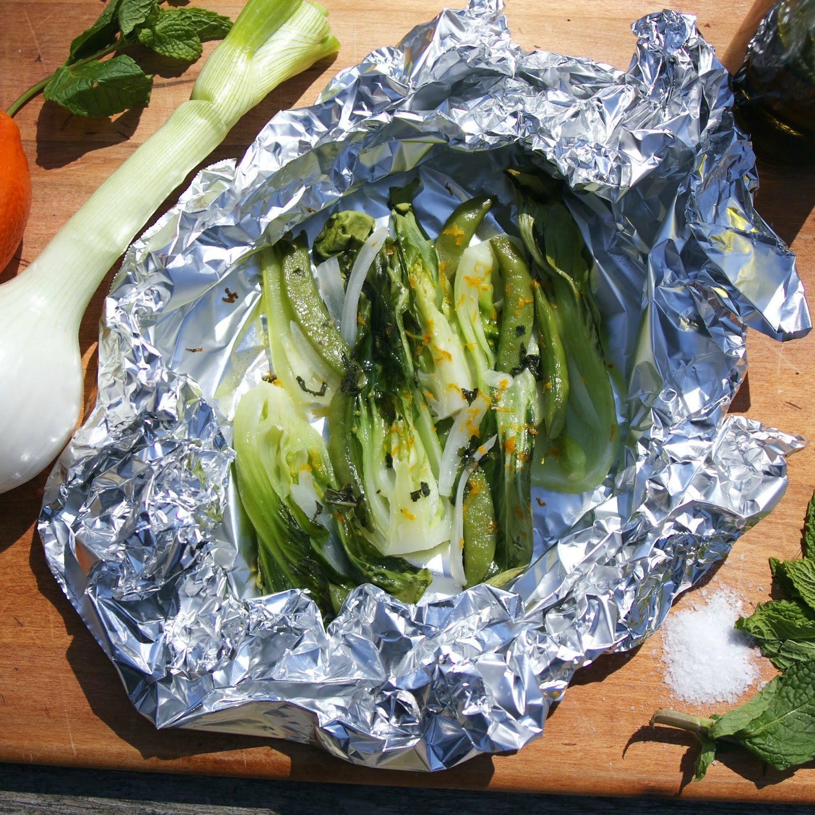 Steamed Bok Choy- baby bok choy, sugar snaps, & garlic en papillote: simplelivingeating.com