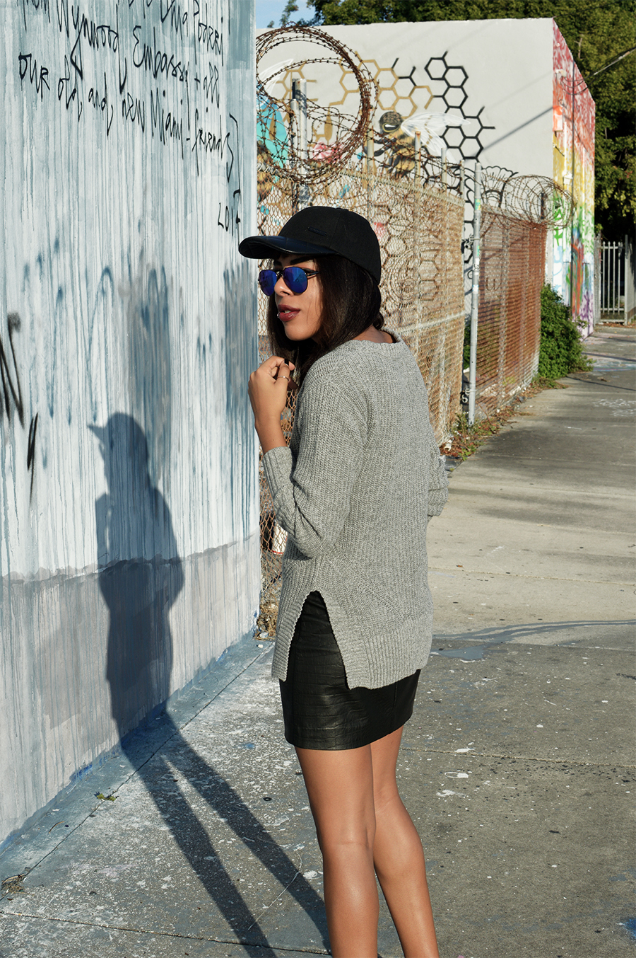 Minimalist indie fashion blogger anais alexandre of down to stars in a grey knitted sweater with h&m leather skirt and ash footwear shoes