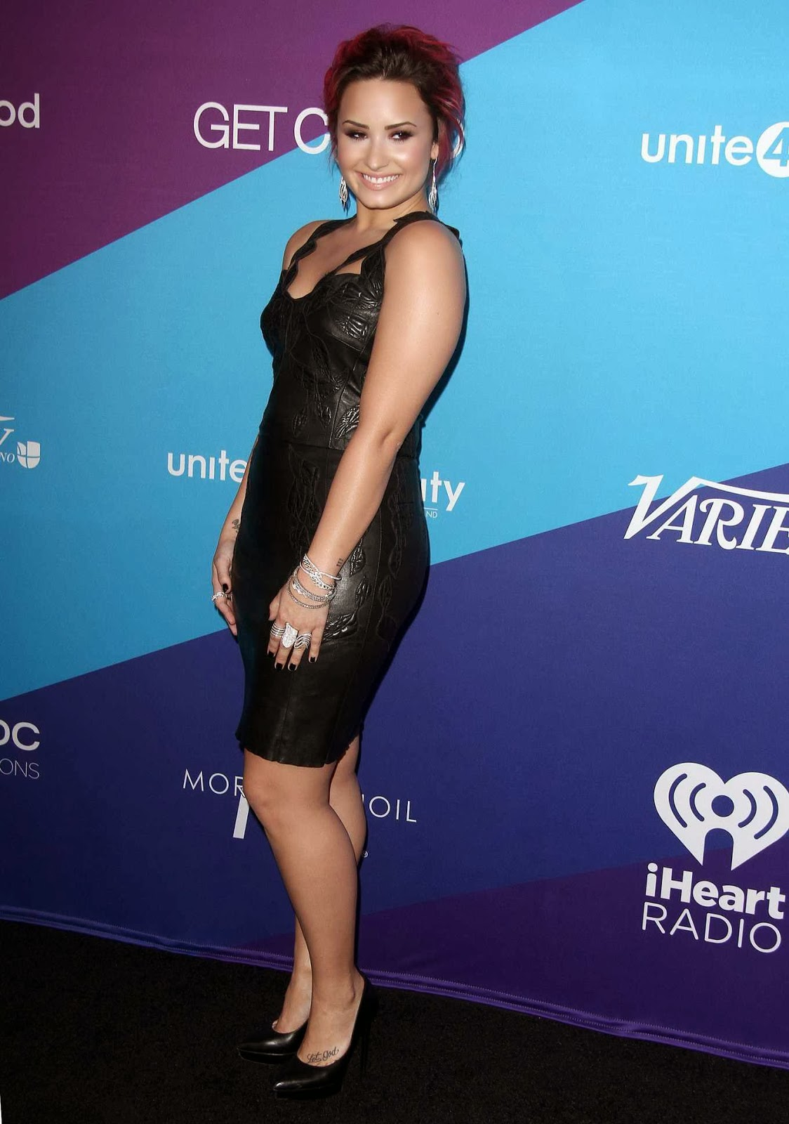 Demi Lovato wearing tight black leather mini dress at 2014 : humanity Gala in Culver City