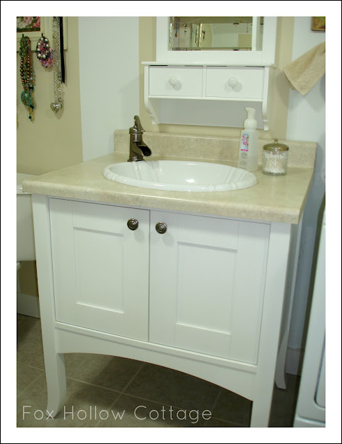 White vanity, trough style farmhouse faucet - Bathroom makeover.
