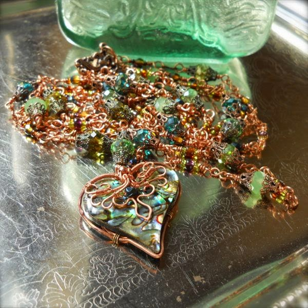 Copper, abalone, copper filigree and green crystal necklace