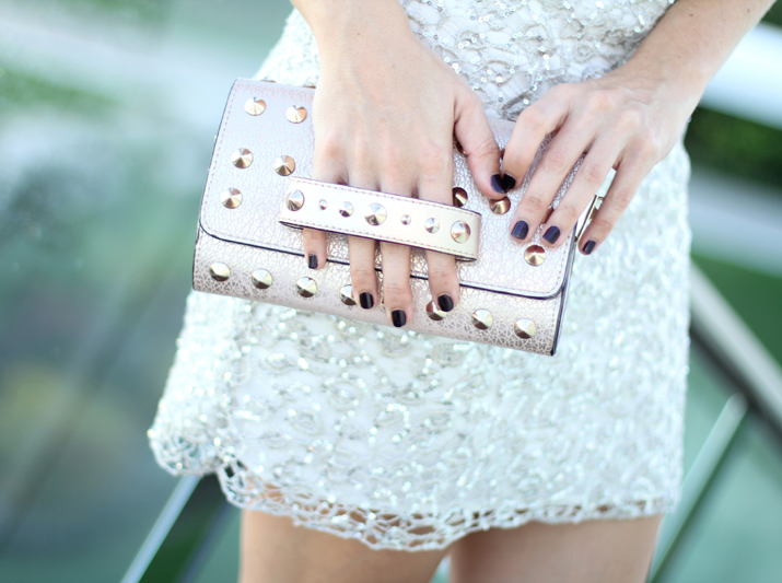 Sutdded clutch and oxblood nails