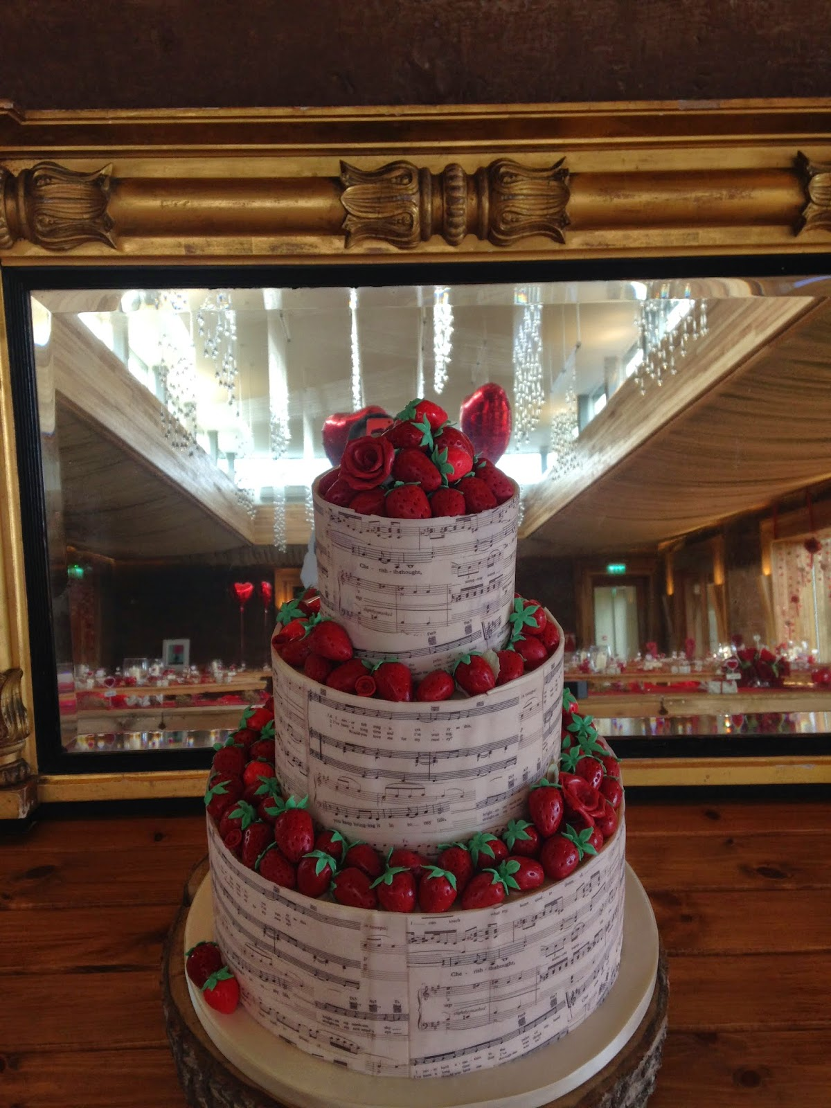 Music sheet and sugarpaste strawberries three tier wedding cake