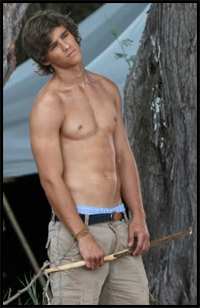 movie still where brenton thwaites wonders how long he has to stand there with his shirt off before someone asks him to take his pants off too