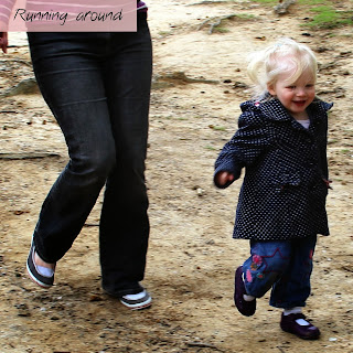 A toddler running being chased by mum