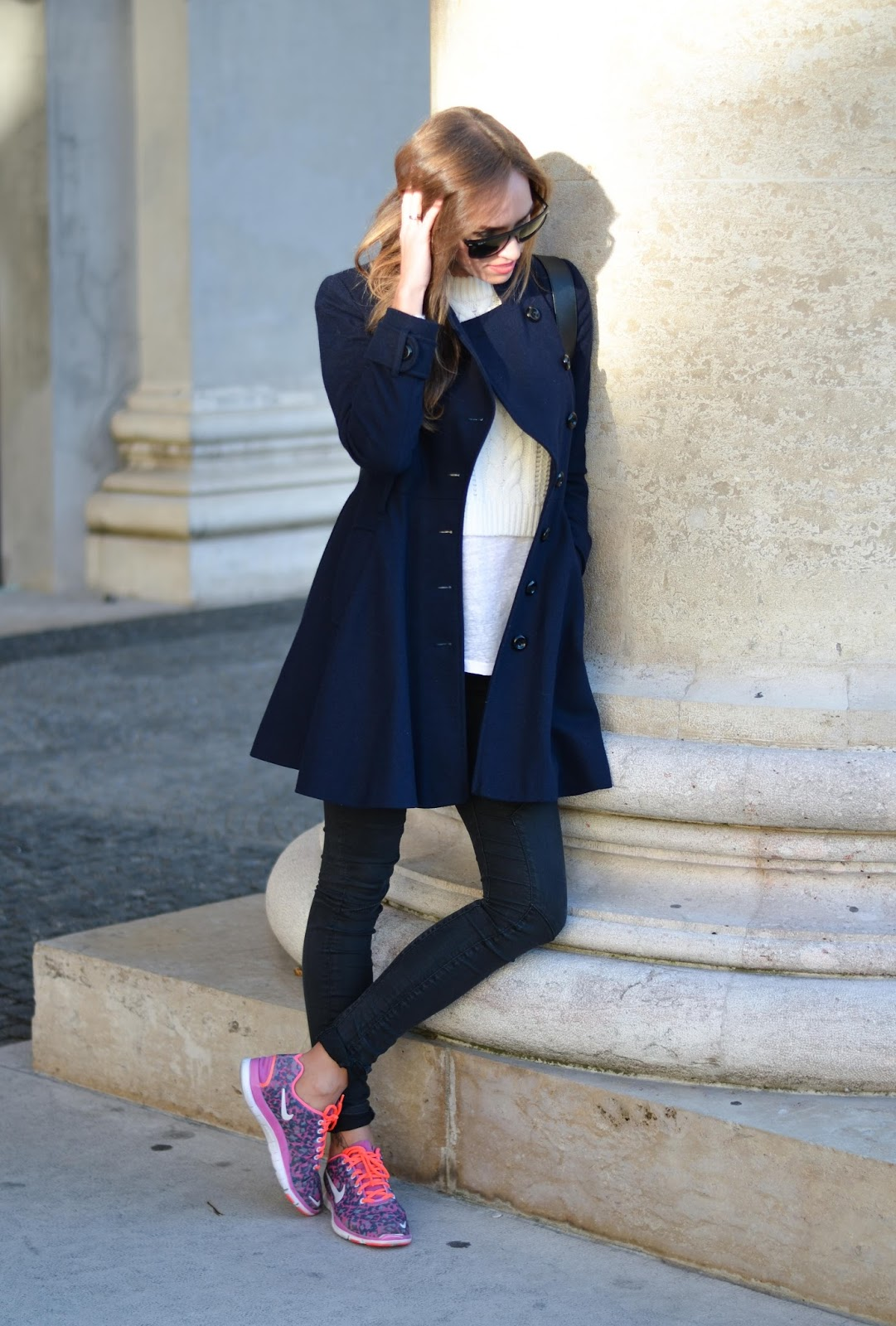 kristjaana mere winter outfit dark blue wool coat white t shirt black jeans pink trainers