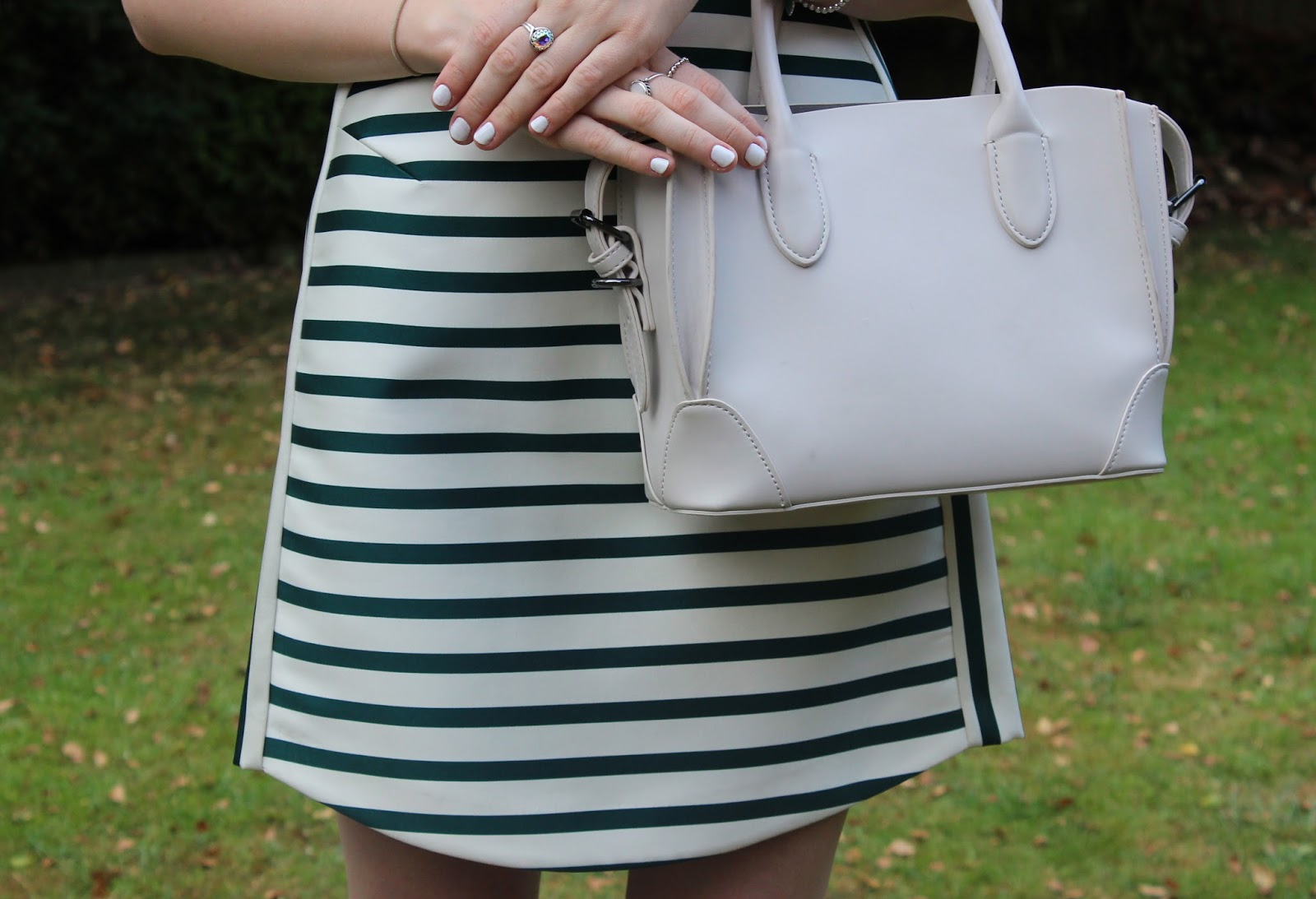 Close up of TOPSHOP stripe dress and Zara Mini Bag