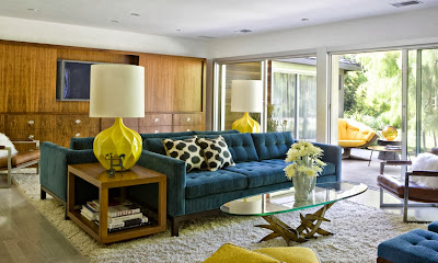 mid century home design with vibrant pops of color and beautiful wood textured furniture