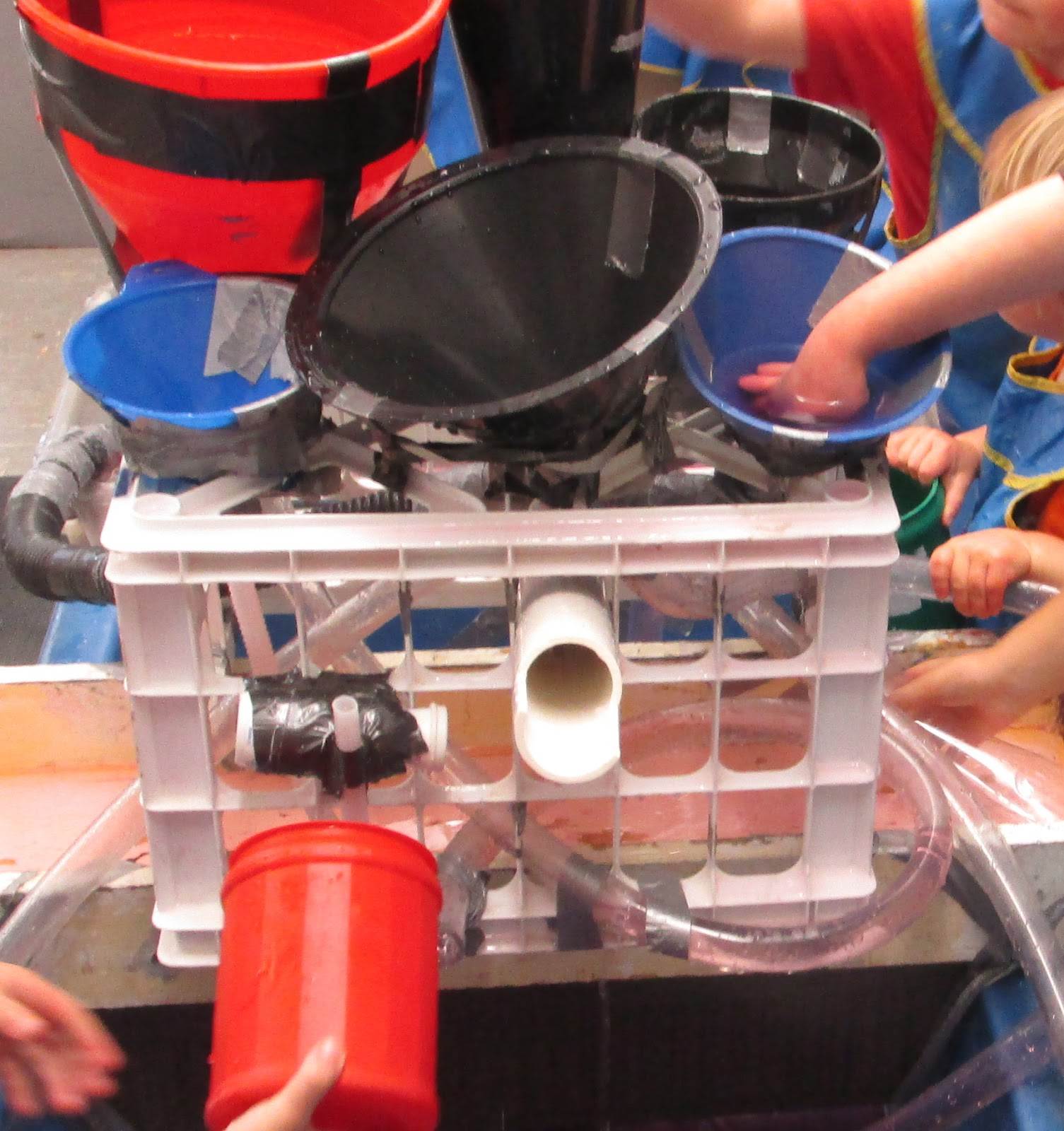 sand and water tables: funnels and clear plastic tubing - 2015