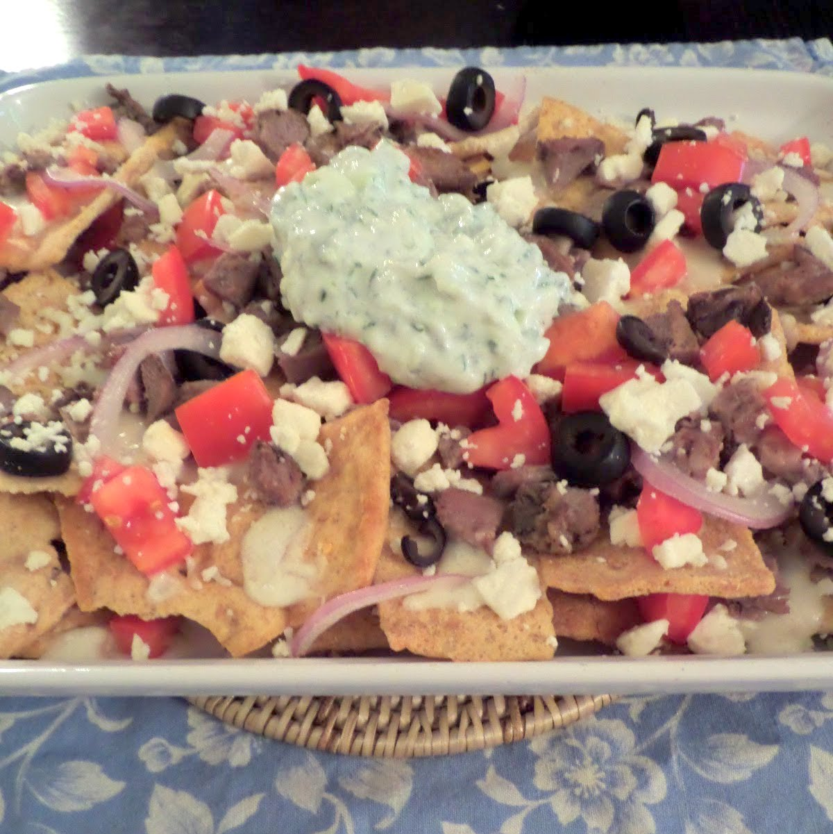 Greek Nachos:  Nachos with a Greek twist.  Pita chips topped with lamb, olives, tomatoes, and feta.
