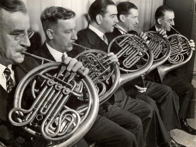 Black and White Picture of French Horn musicians
