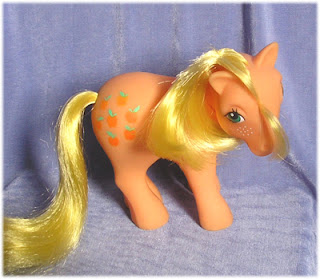 My Little Pony Applejack with yellow mane and tail and orange body