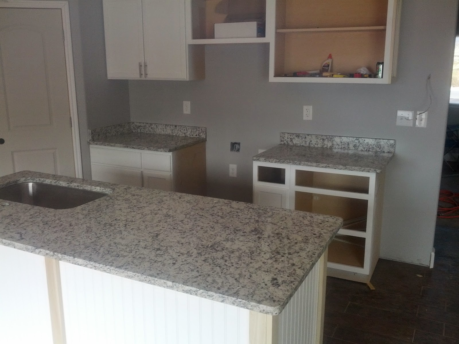 The dallas white granite looks great with the white cabinets and the