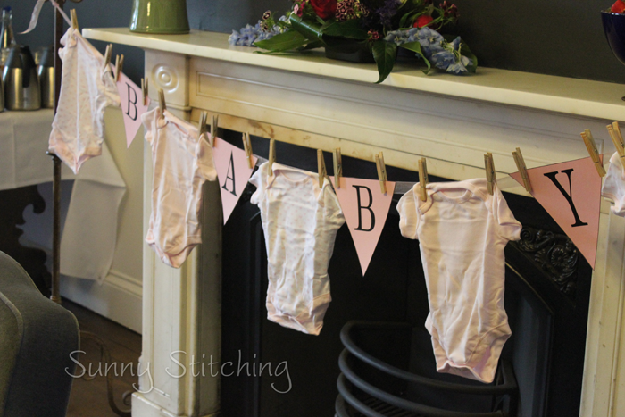 Sunny stitching baby shower decor for Baby clothesline decoration
