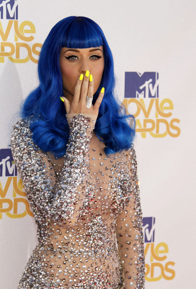 Katy Perry style with blue hair, yellow nails and sparkly rhinestone dress.