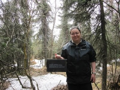 A picture of Anita Wirawan holding the Jody memorial cache.