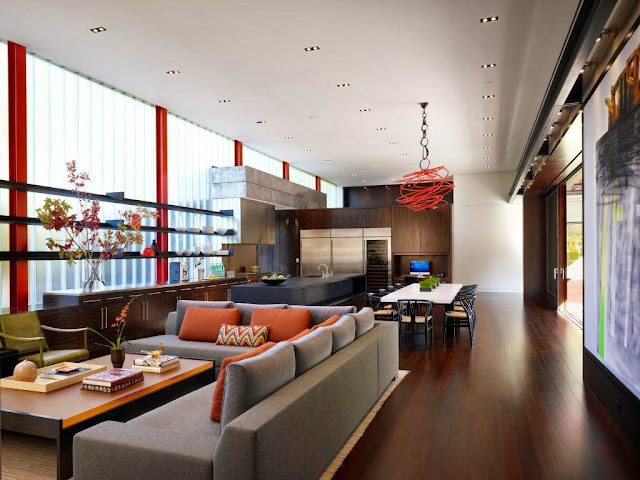 vibrant open plan living area in natural wood tones and pops of color to enlighten spirit