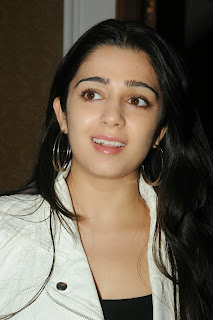 Actress Charmi Kaur Pictures in Jeans at One by Two Movie Celetes 20 Years Event  0017