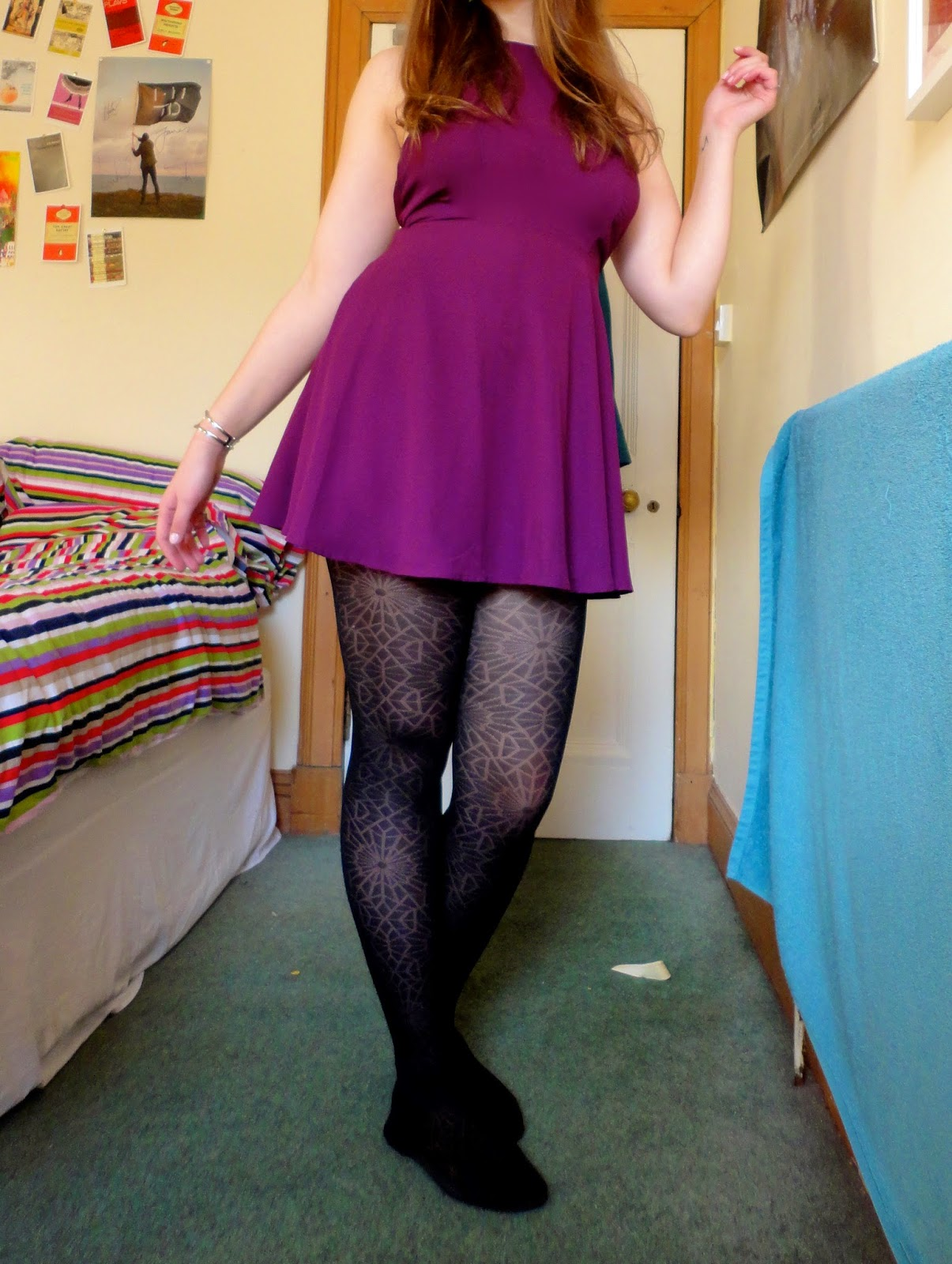 short purple dress with black flats and cobweb tights
