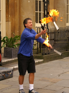 juggler juggling flaming intentions
