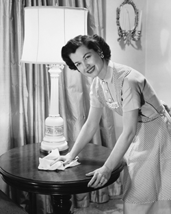 1950's housewife cleans a table