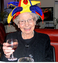 old lady with party hat on