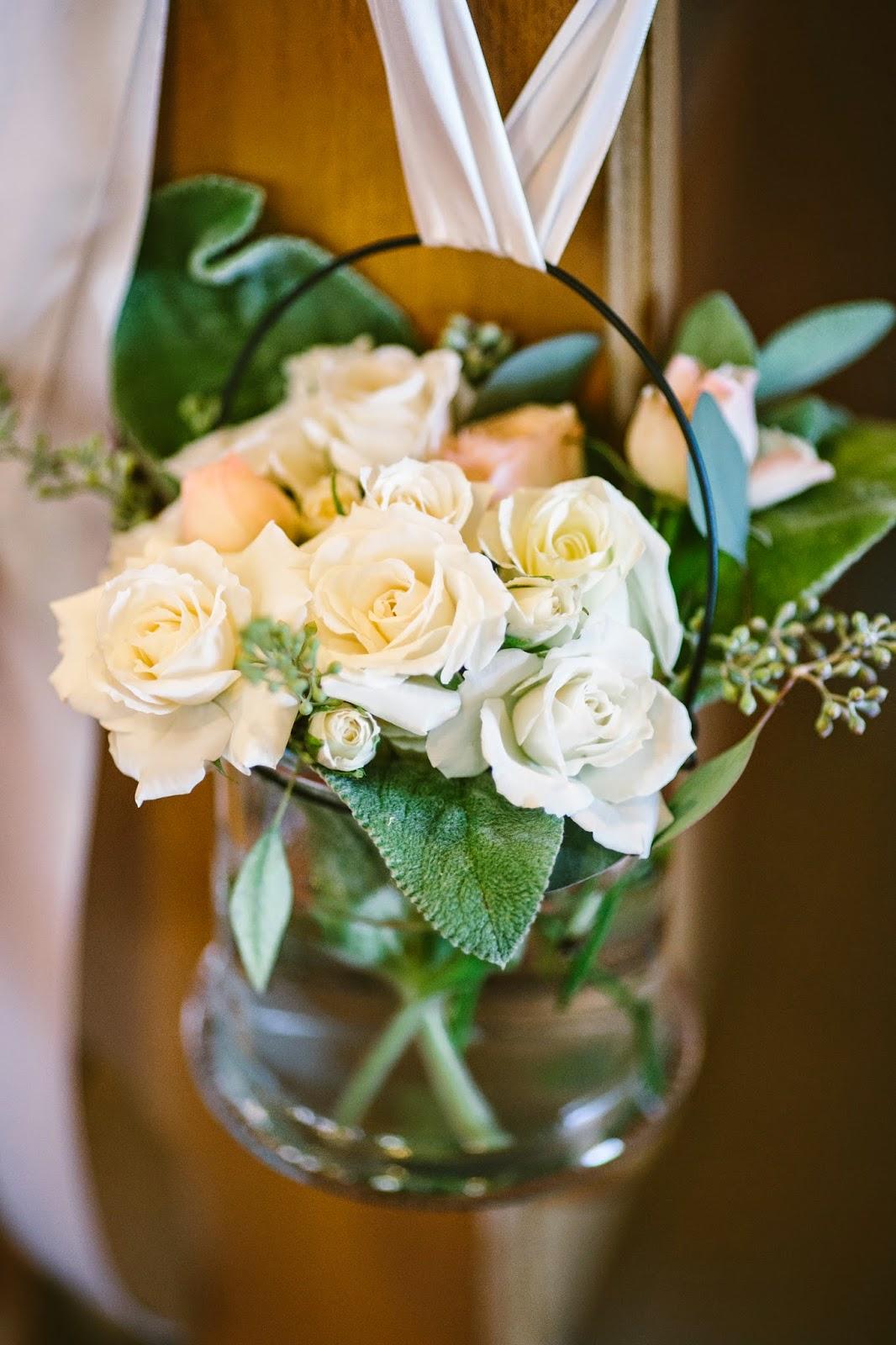 les fleurs : wedding florist : pew arrangements