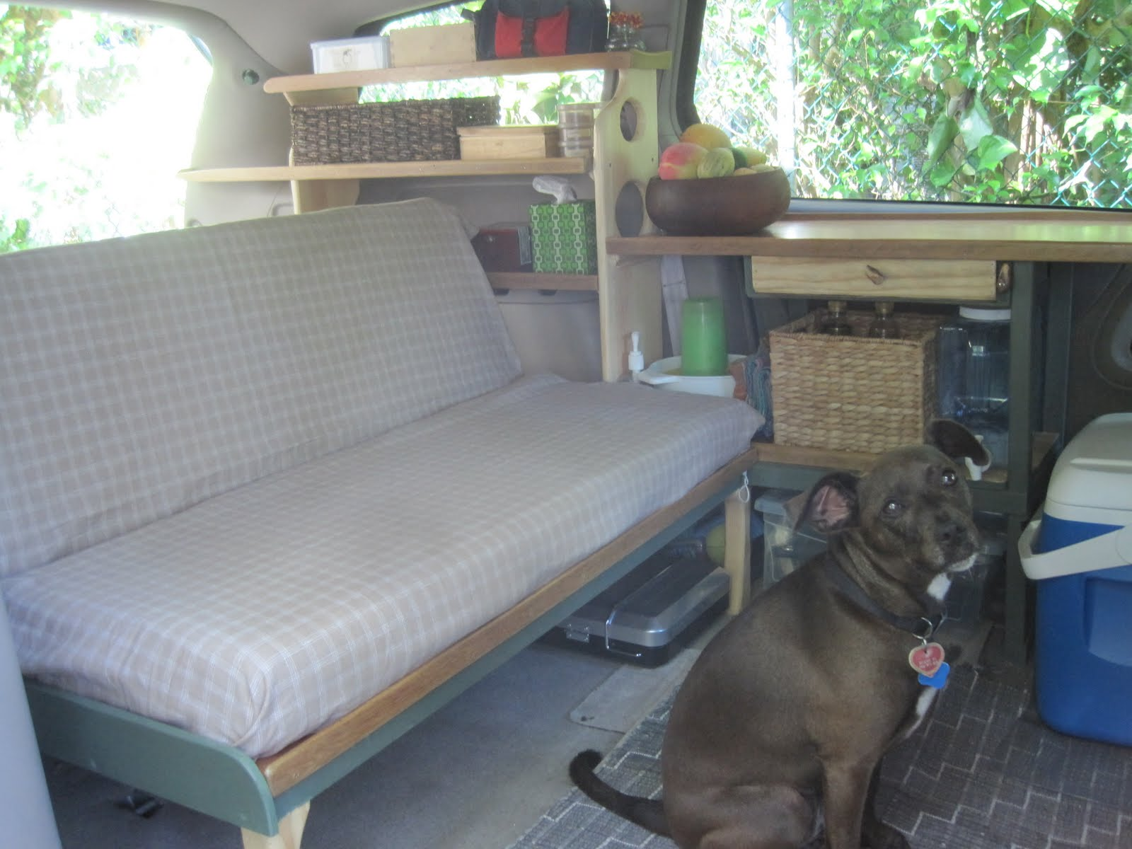 At his point a small brown dog discovered our mini-camper and took up ...