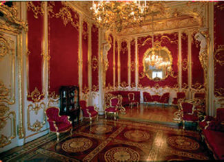 red and gold bedroom boudoir in winter palace or hermitage museum in st.petersburg russia