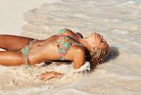 Sylvie van der Vaart cools off in the water